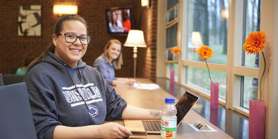 Smiling students with laptop